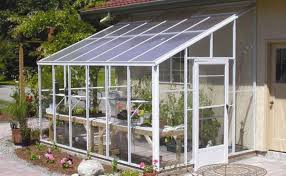 this solargro dover home attached greenhouse features safety glass walls and an insulated