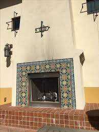 fireplace screens spanish colonial courtyards greece fireplaces iron fire fire places irons