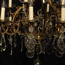 french gilded cast bronze and crystal eighteen light double tiered antique chandelier the leaf