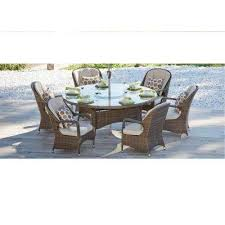 cordella brown 7 piece wicker round outdoor dining set with biege cushions