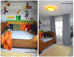 french antique bed in boy s room with grey horizontal stripe walls and yellow chevron rug
