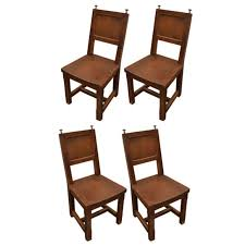 set of 4 wooden dining chairs with silver finials for