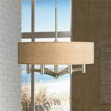 a 6 light pendant chandelier with a woven burlap drum shade