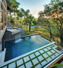 Decorations:Wonderful Outdoor Pool With Waterfall Feature And Surrounded By  Stunning Scenery Water Features to