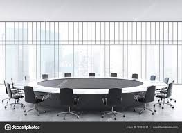 meeting room interior with a large black round table office chairs standing around it and a window with a magnificent view 3d rendering mock up photo by