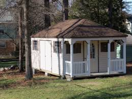 miraculous white wooden shed ideas with white fence veranda and brown sloping roofing for small home backyard home office build
