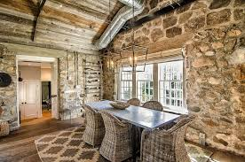 stone wall dining room with cozy cottage charm design kelly and co design