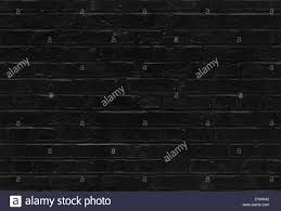 black brick texture. Seamless Black Brick Wall Pattern Texture Background - Stock Image