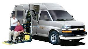 wheel chair lift for van. Adaptavan With Wheelchair Lift Depoloyed. The Van Is Red. Wheel Chair For