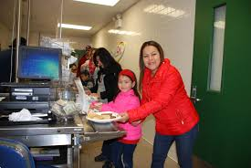 pas and other volunteers in the community helped make the annual pancake breakfast at garden oaks