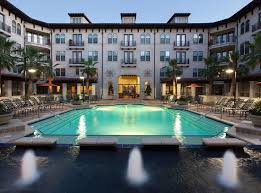 Two resort-style swimming pools at a luxury apartment community near  downtown Houston.