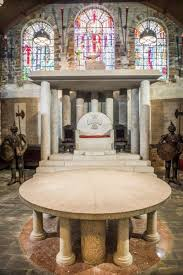 a small round table before the throne
