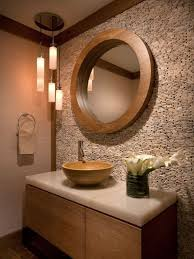round wooden mirror with elegant textured wall and hanging pendant lamps for small bathroom ideas with floating asian oriental vanity