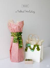 Create An Elegant Centerpiece With Little Gift Boxes Wrapped In Designer Christmas Gift Wrap