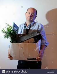 man packs up and leaves the office after losing his job being man packs up and leaves the office after losing his job being made redundant being fired