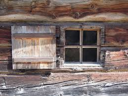 take the glass out chop out the rotten bit and insert a new piece of wood of course there is a limit to how much of a window frame you can replace