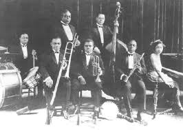 the early influence of louis armstrong on coleman hawkins as  king oliver s creole jazz band in 1923 louis armstrong seated in the centre