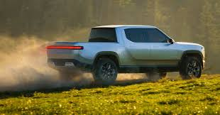 Two ways GM and Amazon can make money on Rivian's electric pickups