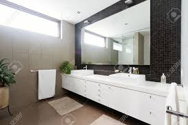 Black Mosaic Tiled Splashback And Double Basin Bathroom Ensuite - Bathroom splashback