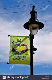 Light Poles California Sunol Stands Against Hate Banner On A Light Pole California