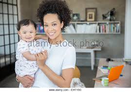 home office multitasking. delighful office portrait of mother and baby daughter in home office  stock image with home office multitasking c