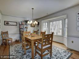 Country Dining Room With Bay Window  Hardwood Floors In - Bay window in dining room