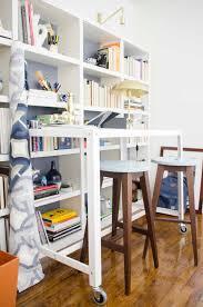 modern standing desk home office with bookshelves on thouswellblog