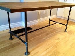 i can use as an island and table great details including supply list for a diy table with plumbing pipe legs and trestle