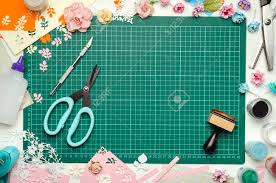 Paper Flower Cutting Tools The Cutting Mat Is Surrounded By Paper Flowers Paper Tools And