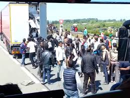 Image result for migrants in calais boarding trucks