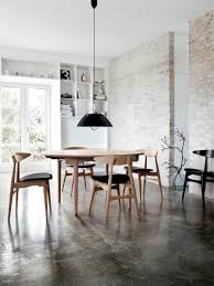 urban rustic stained concrete exposed brick clean lines white lots of natural light