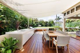 retractable patio awning diy by diy retractable awning deck midcentury with outdoor table
