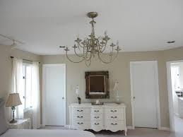 the above picture is from the first set of renovations i did to our master bedroom i found that giant chandelier also originally brass and decided that