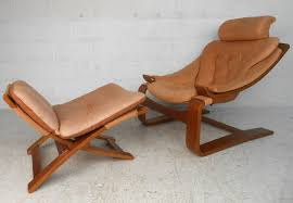 this unique pressed beech chair features a comfortable slung seat framed with a unique cantilever design