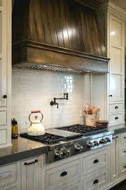 do quartz countertops stain kitchen features stained kitchen hood creamy white cabinets and grey quartz