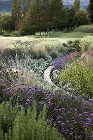 The Curve Just Adds To The Beautiful Tapestry Of Perennials Int His