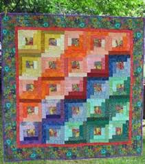QuiltMasters Quilt Idea Gallery: Sample Quilt Designs and Inspirations & This traditional pattern represents the early American home. The center  square traditionally was red to represent the hearth, the heart of the home. Adamdwight.com