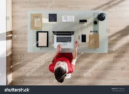 glass table top view. Top View, Young Woman Sitting At Glass Desk And Working On Her Laptop, Table View P