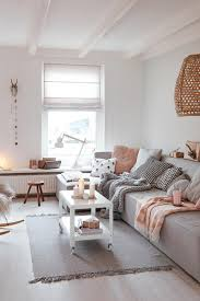 Scandinavian living room with neutral colors and pastel pink ...