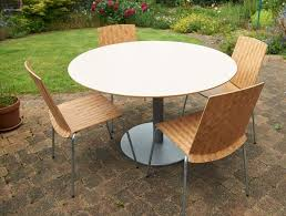 round table ikea billsta model and four stackable ikea elliot chairs