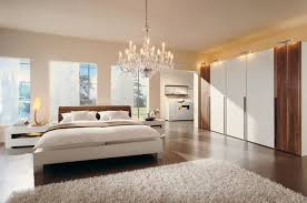 luxury crystal chandelier for extra large bedroom decorations with modern big wardrobe using sliding door