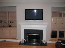 mounting tv above fireplace mounting above brick