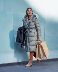 she wears lightweight down hooded coat melange wool tunic heattech high rise leggings pants cashmere scarf