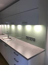 sage green kitchen glass backsplash