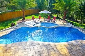 pool design ideas. Enchanting Inground Pool And Spa Design Ideas With Four Red Chairs Umbrella Trees Surrounding