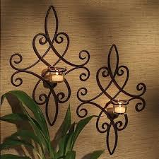 wrought iron wall decor this pair of iron wall sconces can be displayed at graduated heights