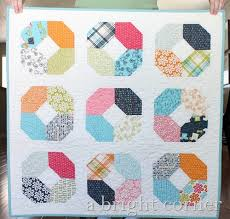 Bust Your Stash with These Charm Pack Quilts: 8 Patterns to Try & Charming Lucy Quilt Adamdwight.com
