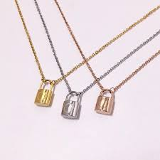 whole fine titanium steel jewelry whole 18k gold plated exquisite fashion men and women models small lock pendant necklace long necklaces fine