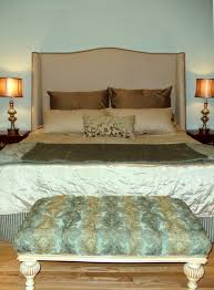 Upholstered Headboard on a hidden metal frame. If your dust skirt is plain  (not gathered), you rarely notice the dust skirt.
