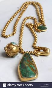del image of long gold chain turquoise pendant and bird from the afghan collection by jewellery designer pippa small at